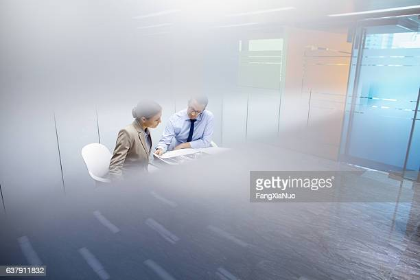 business colleagues meeting together in room - mystery stock pictures, royalty-free photos & images