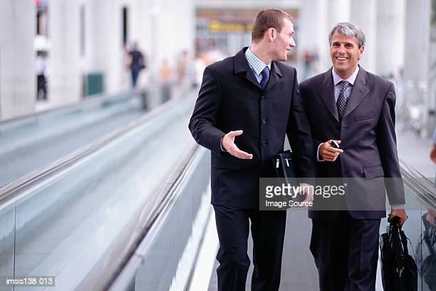 Business colleagues on travelator