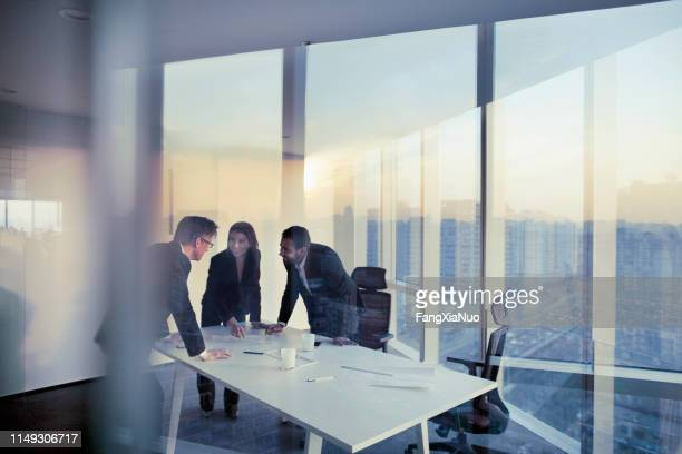 business colleagues planning together in meeting - leaning stock pictures, royalty-free photos & images