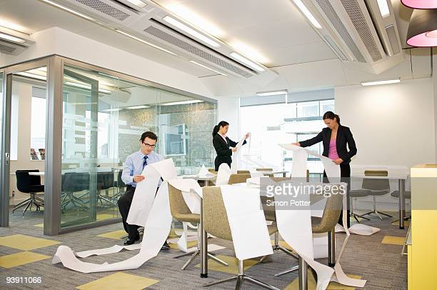 business colleagues search computer data - excess stock photos and pictures