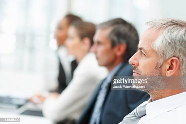 Business colleagues sitting in a row