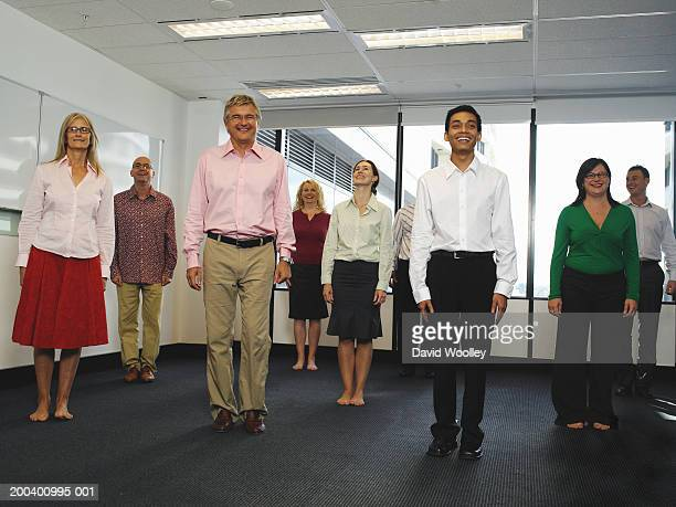 Business colleagues standing in office, smiling