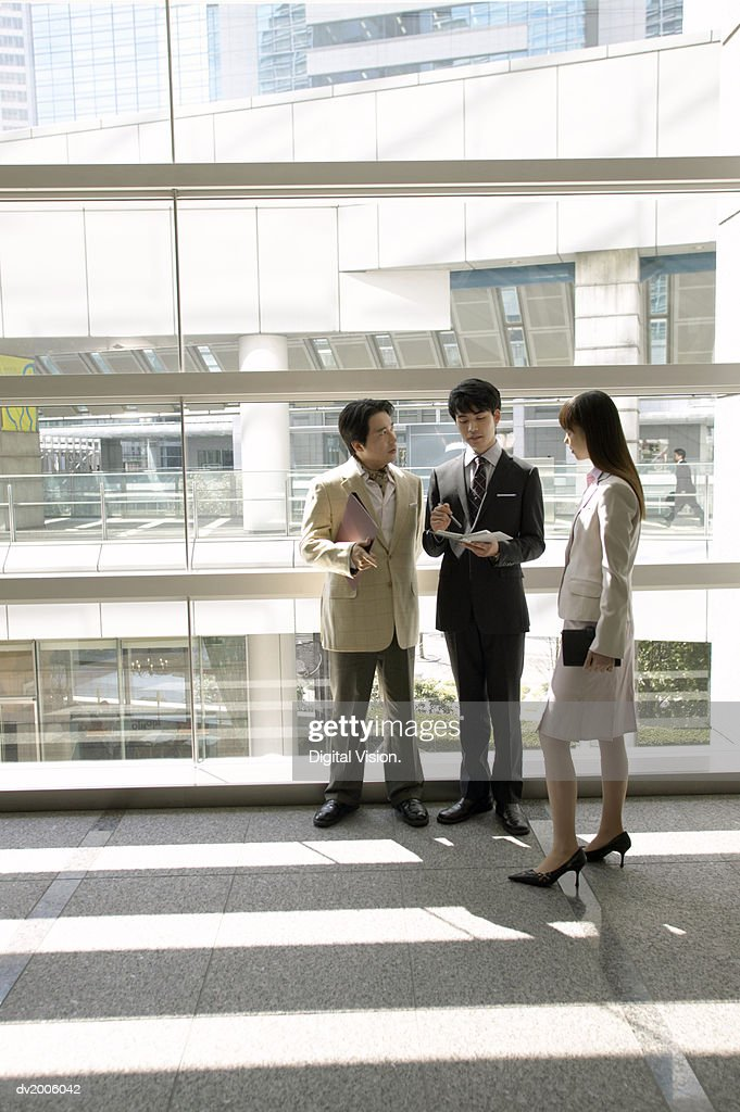 Business Colleagues Talking in an Office : Stock Photo
