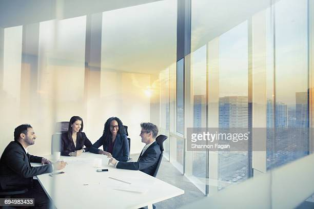 Business colleagues talking in meeting room
