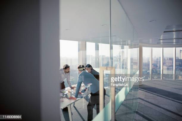 business colleagues talking in planning meeting - leading stock pictures, royalty-free photos & images