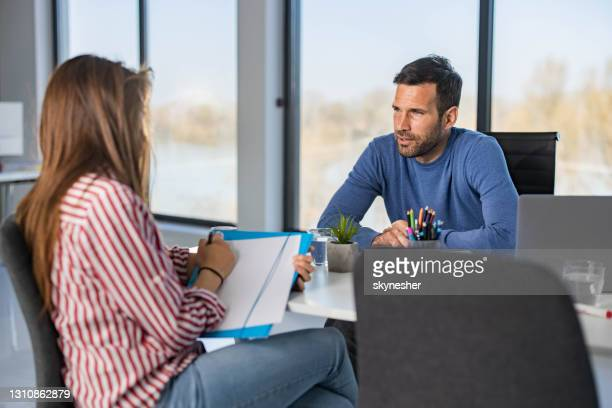 business colleagues talking on a meeting in the office. - mortgage stock pictures, royalty-free photos & images