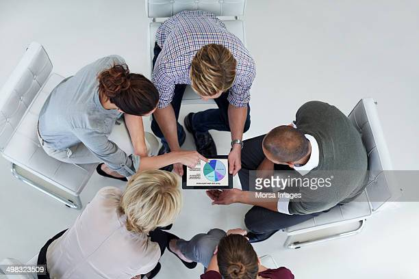 Business colleagues using digital tablet together