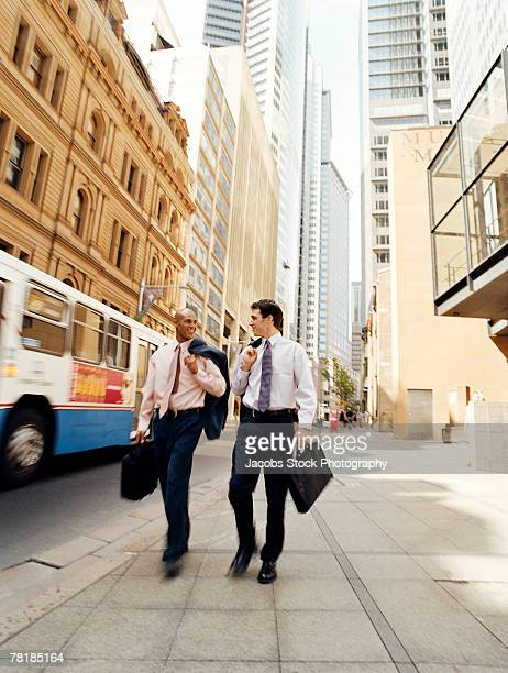 Business colleagues walking down the street