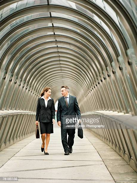 Business colleagues walking in a walkway