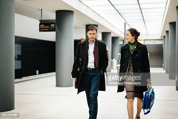 Business Colleagues Walking in Subway Station