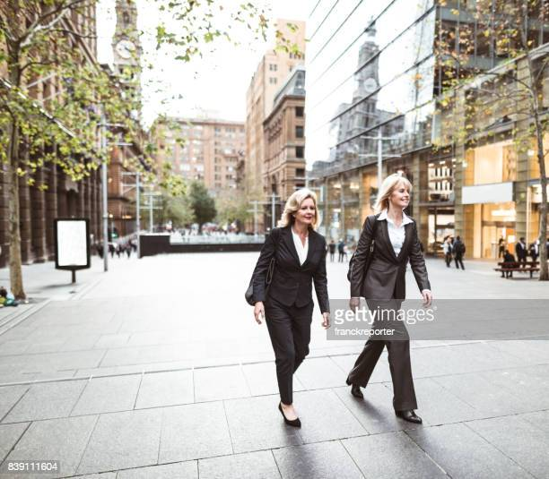 business colleagues walking on the city