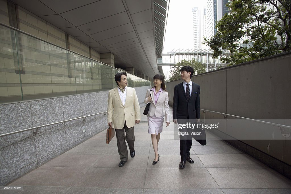 Business Colleagues Walking Up a Concrete Ramp : Stock Photo