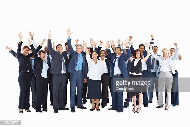 Business colleagues with arms raised over white background