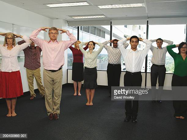 Business colleagues with hands on heads in office