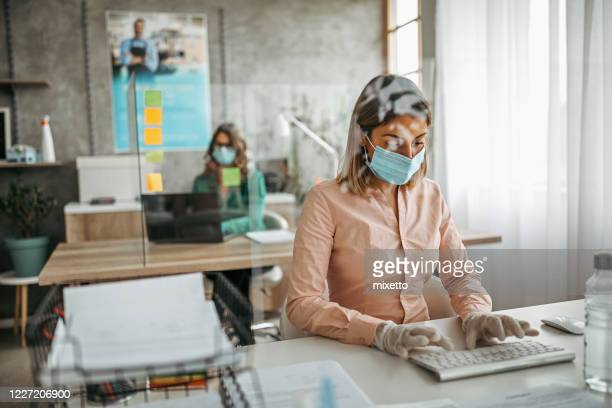 business colleagues working at office by maintaining social distance - social distancing stock pictures, royalty-free photos & images