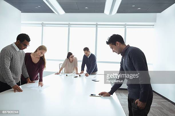 business colleagues working together in meeting room - real estate office stock photos and pictures