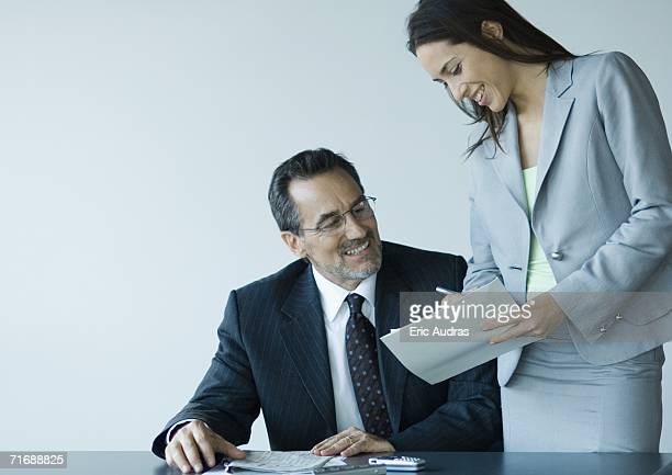 Business colleagues working together, smiling