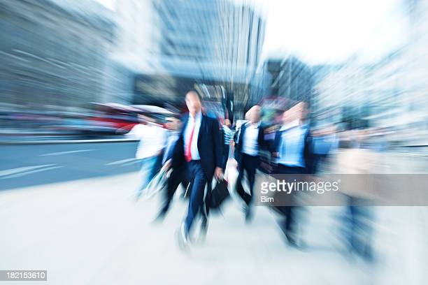 Business Commuters Walking Down Street, Blurred Motion, London, England