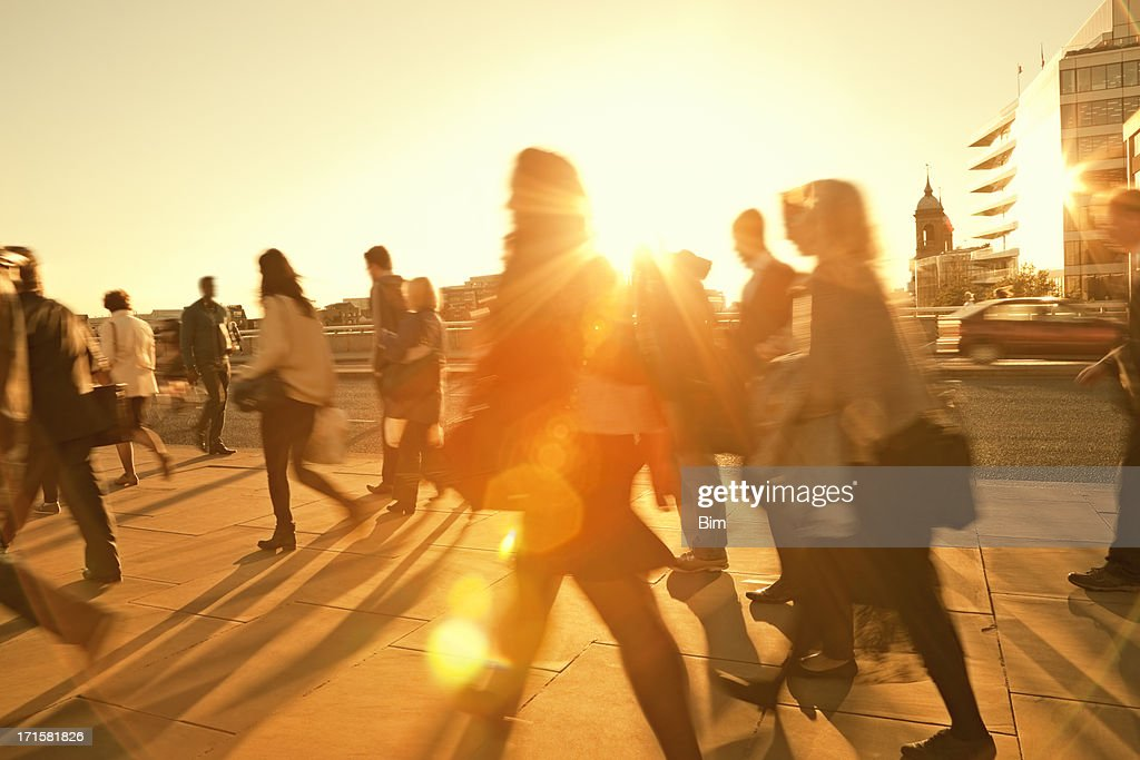 Business Commuters Walking Home After Work, Sunset Backlit, Blurred Motion : Stock Photo