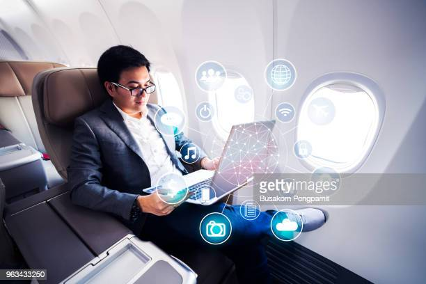 business concept, businessman working laptop. generic design notebook. worldwide connection technology interface, horizontal - marketing icons stock photos and pictures