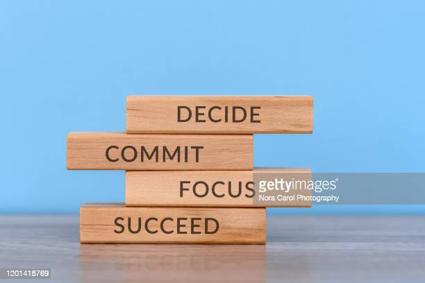 business concept decide, commit, focus, success wood block - motivation stock pictures, royalty-free photos & images