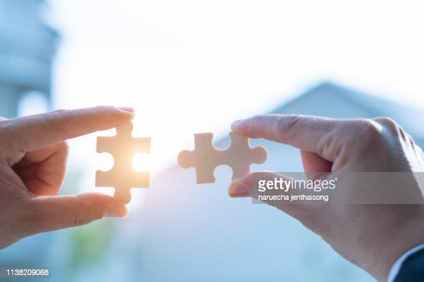 business concept, jigsaw puzzle shows cooperation, unity will lead to success. - 電動糸のこ ストックフォトと画像