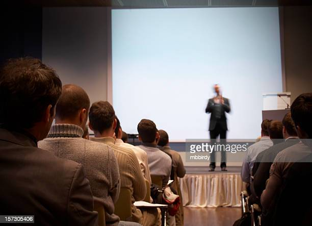 Business conference in a hall with white screen