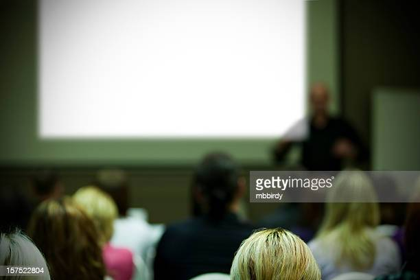 business conference with businessman talking to audience - overheadprojector stockfoto's en -beelden