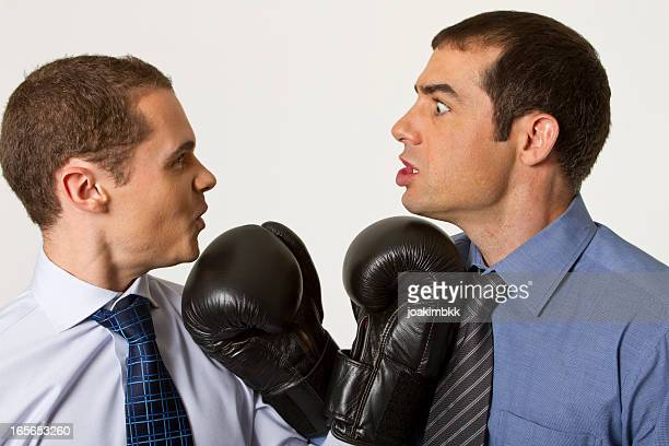 business confrontation with boxing gloves - funny boxing stock photos and pictures