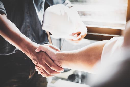 Business Cooperation, Construction, Design agreement concept. Handshake between designer engineers 1072011828