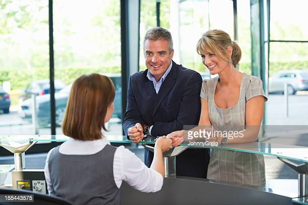 Business Couple At Reception Desk