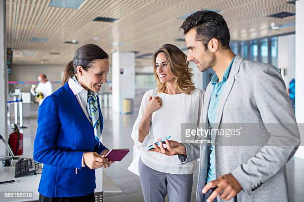 Business couple boarding to plane at airport