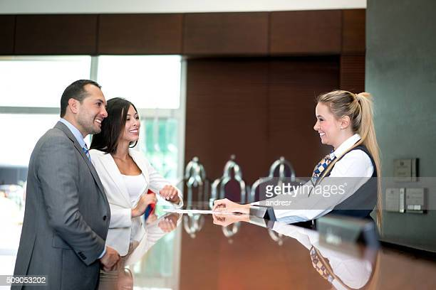 Business couple doing check in at the hotel