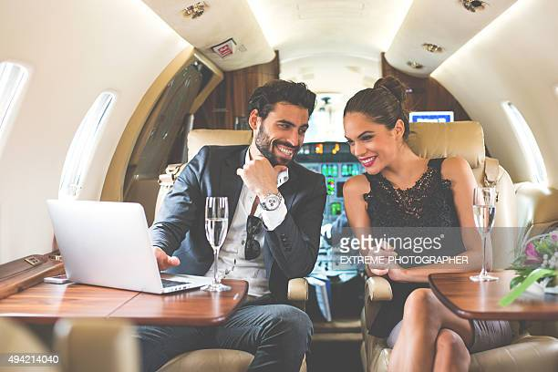 Business couple enjoying in private aeroplane