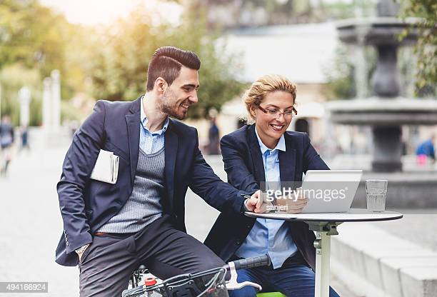 Business couple having meeting on the street