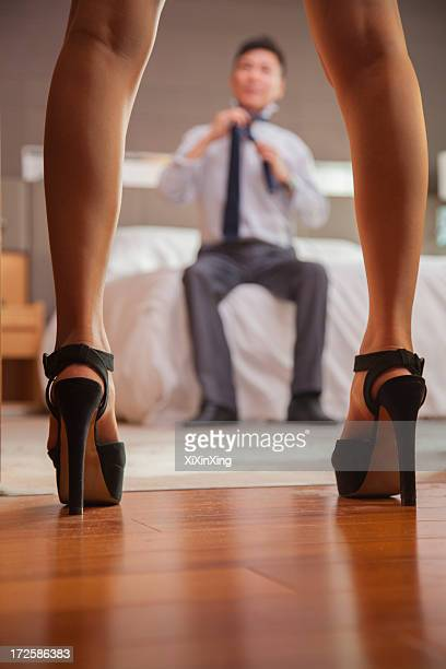 Business couple in hotel room