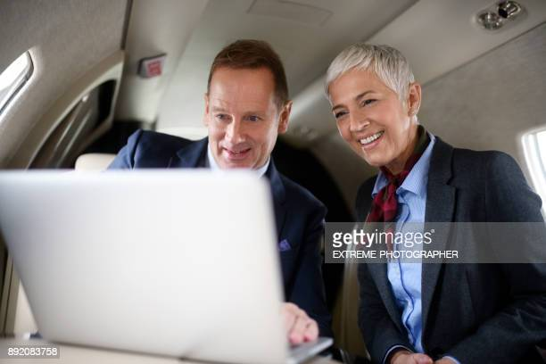Business couple in private jet airplane