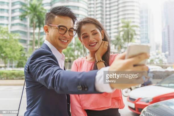 Business Couple Kuala Lumpur Smart Phone Selfies Malaysia