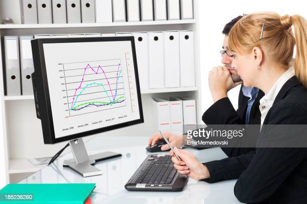 business couple  looking at graph chart