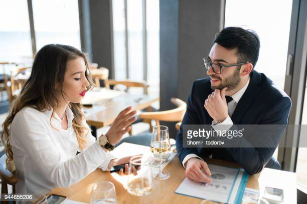 Business couple lunching at fancy restaurant