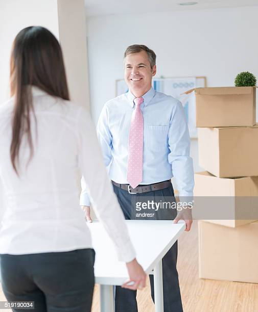Business couple moving to a new office