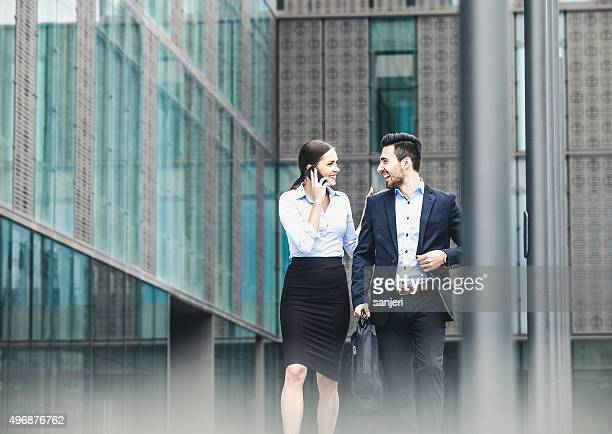 Business couple outdoors meeting