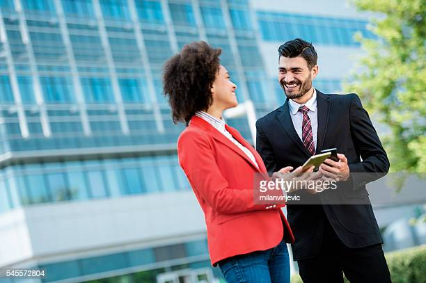 Business couple smiling outdoors