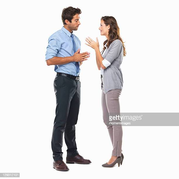 business couple standing and having discussion - non verbal communication stock photos and pictures