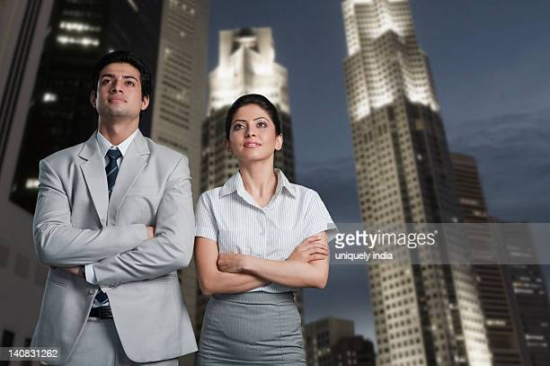 Business couple standing in a city
