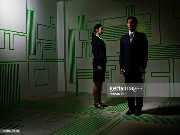 Business couple standing in the Circuit Board room
