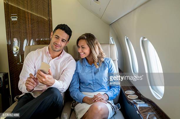 Business couple traveling by plane