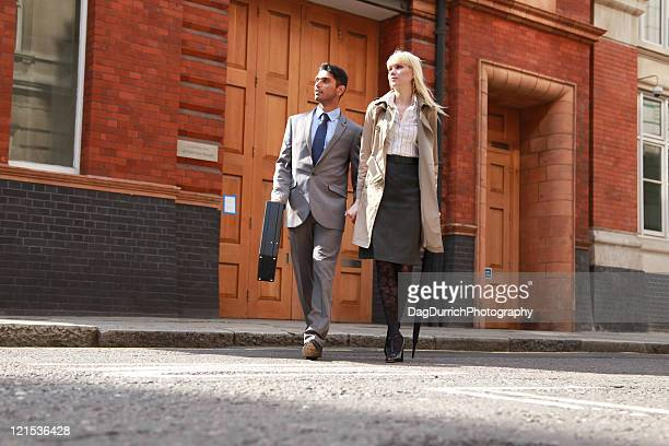 Business couple walking