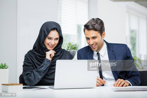 Business couple working together on project at startup office