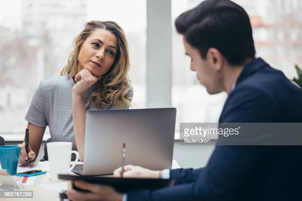 business couple working together - work romance stock pictures, royalty-free photos & images